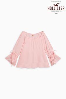 Różowa bluzka z odkrytymi ramionami Hollister