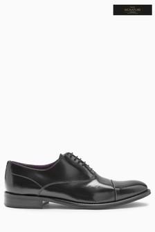 Фирменные туфли с отделкой на носке