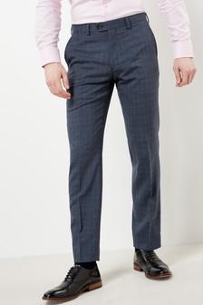Коллекционный костюм фасонного кроя в клетку: брюки