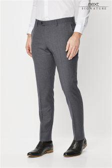 Коллекционный фактурный костюм зауженного кроя: брюки