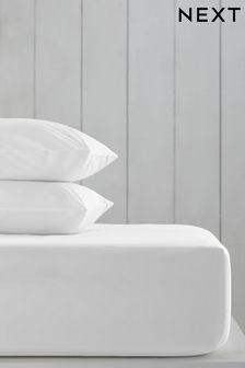 Sábana ajustable profunda con diseño teñido liso en alto contenido de algodón