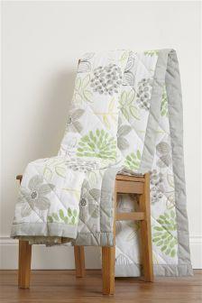 Jeté réversible motif floral vert