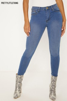 PrettyLittleThing Low Rise Mid Wash Slim Leg Jeans